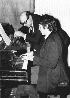 Paul works out horn parts with a session musician. Sgt Pepper, 1967