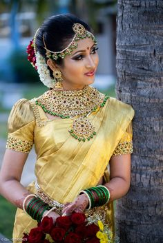 South Indian Bride in stunning green and gold set looks beautiful with her yellow sari. South Indian Wedding Saree, Indian Bridal Wear, South Indian Bride, Wedding Sarees, Wedding Blouses, Kerala Bride, India Wedding, Hindu Bride, Bridal Sarees