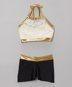 Two piece crop top, Top is a light cream, cover in a cream lace bound in gold.  Shorts are black with a gold waistband.