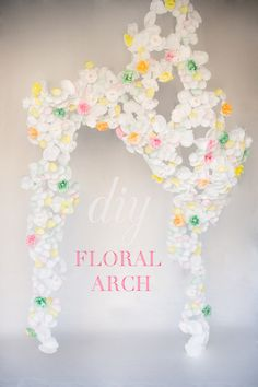 diy paper flower arch - love this! Check out the website! It looks so cool in the photos could be a good back drop for a walk down the aisle... Jamie! Into the paper flowers!