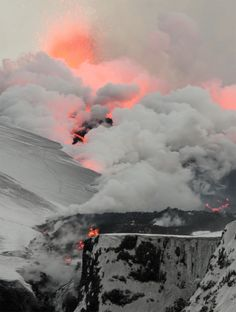 Overview of the 2nd fissure on Fimmvörðuháls, close to Eyjafjallajökull, as the lava flows down towards the north, turning snow into steam, 2 April 2010 by Henrik Thorburn