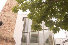 Illa de Arousa Auditorium located on the ground of a former canning factory. Architect: Manuel Gallego Jorreto. #illadrearousa #island #architecture #ríasbaixas #factory #conservera #auditorio #tour #gasantiago #guidingarchitects #travel #galicia