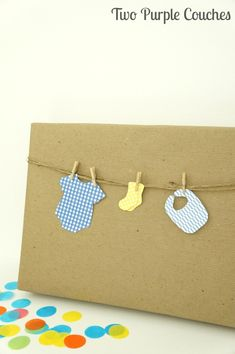 Adorable DIY idea for wrapping a baby shower gift! Just trace and cut shapes, then attach with mini clothespins.