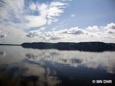 Lake Pepin showing calm waters and a blue ski with some clouds.