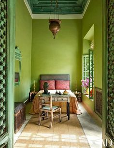 A 19th-century Persian light hangs in the Green Bedroom of a Marrakech house that belonged to the late Chilean artist Claudio Bravo.