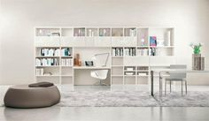 Minimalist and Shelving Systems in Bright Colors: White Shelving System For Book Collection And Dark Ottoman Furniture ~ tonlok.com Furniture Inspiration