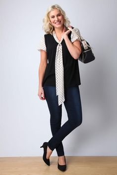 A blouse, cardigan, jeans and heels look professional, while still maintaining a casual vibe