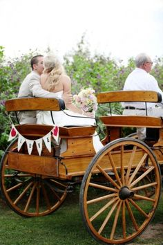Horse drawn carriage with DIY bunting from Tiffany + Brandon's Shabby Chic DIY Wedding