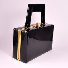 mod black purse.  I think you should say purse not bag when it's vintage...just saying. #carteras #bag in #modaoperandi