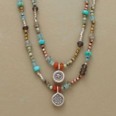 TEXAS TWO-STEP NECKLACE--Two stamped charms step out on their own from a lively line dance of gemstones and beads in turquoise, smoky quartz, carnelian, apatite, labradorite, copper, brass, and sterling silver. Textured links knotted to brown leather