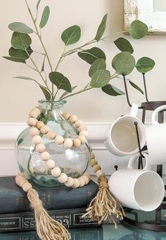 An easy tutorial for creating a $5.00 wood bead garland with tassels! www.littlehouseoffour.com