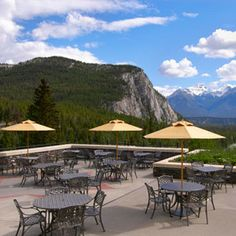The patio at Rundle Lounge at Fairmont Banff Springs is something you have to see to believe. With sweeping views of the mountains and the Bow and Spray Rivers below, this is the perfect place to relax and unwind in the Canadian Rocky Mountains.