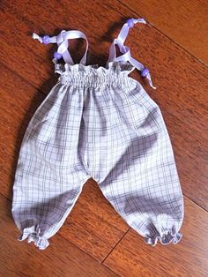 All in French - but it's not hard to get an idea of how she creates these gorgeous little overalls