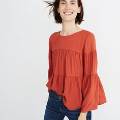 A flowy top in a pretty tiered silhouette with a fresh button-back detail. So good with jeans (no surprise there) and perfect all that holiday eating *hint hint*. <ul><li>True to size.</li><li>Viscose.</li><li>Hand wash.</li><li>Import.</li></ul>