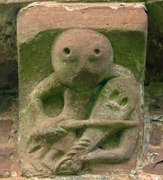 """Kilpeck Church, Herefordshire, 1140 AD. """"A fiddle player who looks suspiciously like the sheela-na-gig's brother also symbolises low morality. Well we all know the devil has the best tunes!"""" Simon Jenkins"""