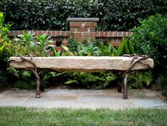 Bench, reclaimed granite with sculpted metal branch legs. The Collins Group