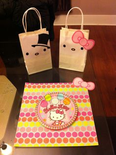 Hello Kitty boy and girl bags. :D