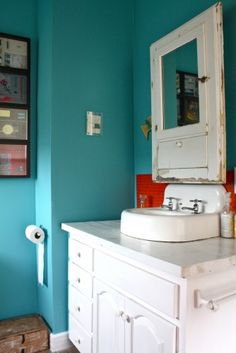 1000 images about orange teal bathroom on pinterest for Blue and orange bathroom