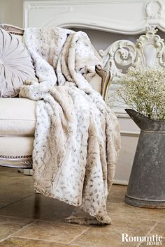 Blankets are cozy and warm in the winter, but most of us think of them as a utility item rather than a decor object.