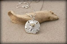 ©Cheydrea - Sterling Silver Jewelry and Beach Weddings. ♥ Ready to Ship! FAST SHIPPING!  ♥ A beautiful rustic organic style keepsake for any lady who loves the beach. Sterling Silver organic style sand dollar with a freshwater pearl or choose a birthstone if you prefer. See photo 4  ♥ Size of sand dollar is 20mm (a bit smaller than an inch in diameter) ♥ Sturdy Modern Chain - Choose your length. See Photo 3 for length samples. ALSO AVAILABLE WITHOUT A CHAIN (if you dont need a chain). See…