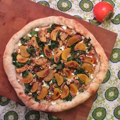 #PizzaTuesday Medlar & Roasted Persimmon #Pizza: Smashed medlar fruit, goat cheese, roasted persimmon & mushroom medley (oyster, shiitake, baby bella), walnuts, kale with lemon juice
