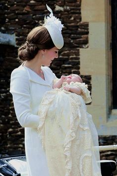The Duchess of Cambridge and Princess Charlotte of Cambridge arrive at the Church of St Mary Magdalene on the Sandringham Estate, July 5, 2015.