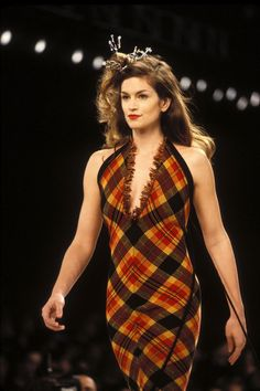Cindy Crawford wears a plaid dress and metal hairpiece for todd Oldham in 1994