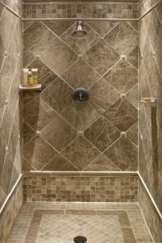 Master Bathroom Shower using the idea of clipped corners --- Milano Cappuccino Tile with Marazzi Romancing the Stone 2 x 2 tile. Entire shower done like this.