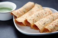 These spicy savoury pancakes made from chick pea (gram) flour hail from Gujarat in India. But a version of it with onions and tomatoes is also cooked in North India called Chilla.