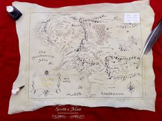 Middle-Earth map hand-drawn on calfskin parchment with goose feather
