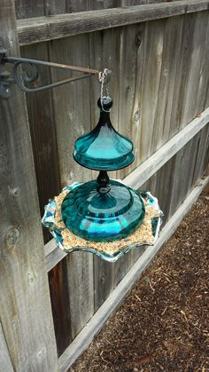 Teal and iridescent blue drepressed carnival glass hanging bird feeder gardenbirdfeeders Bird House Feeder, Hanging Bird Feeders, Diy Bird Feeder, Garden Totems, Glass Garden Art, Glass Art, Outdoor Crafts, Outdoor Art, Glass Flowers