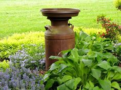 Old Milk Can used for a bird bath
