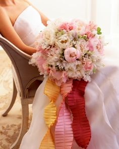 Full Effect  An abundance of large blush pink and cream peonies is mixed with smaller clematis and sweet peas to make this opulently romantic bridal bouquet. Three pleated shantung-silk ribbons echo the peonies' feathery lightness.