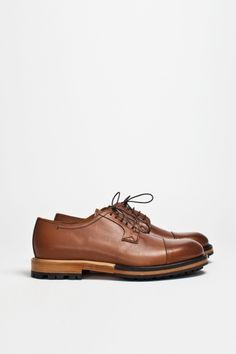 b1dbf8929cac Elegant derby shoes from Lanvin. Upper in premium calf skin with a cap toe.  Contrast stitching and rounded laces. Fully leather lined.