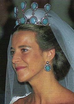Cayetana, Duquesa of Alba's niece, Blanca Martinez de Irujo, wearing a large tiara featuring five pinnacles of circular and pear-shaped turquoise, with matching ear pendents, when she married Francsico Rivera.