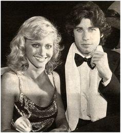 John Travolta and Olivia Newton John. I'm pretty sure they have the same haircut.