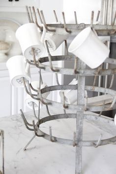 French bottle drying rack!  I have two of these beauties at American Home & Garden in Ventura CA