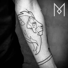 Continuous line lion tattoo on the left forearm. Tattoo Artist: Mo Ganji