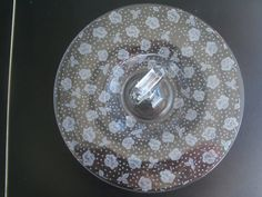 Up for sale is this Vintage Etched Glass Rose Design Handled Sandwich Plate in great condition with no chips or cracks. It measures approx. 10 1/2 inches wide. The Etching is on the reverse. Everything we offer at auctions is pre - owned &/or used. This item(s) may show some signs of wear commensurate with age & normal use.  Shipping Excludes: Alaska/Hawaii, US Protectorates, APO/FPO, PO Box Shipping Provided to the United States Only