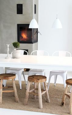 mix of white chairs + wood stools
