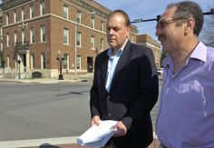 Ed McDonough and Michael LoPorto hold a press conference in front of the Troy Police station before they turned over new evidence in the Troy Voter Fraud Trial. (Mike McMahon / The Record)
