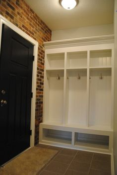 I like the door way with the brick and the cubbies in the mudroom  Entertaining Area Photos - Bridgeport Custom Homes, Medina, Ohio