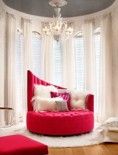 Sexy, luxurious, and sumptuous bedroom. Fur pillows and tufted red velvet - perfect romantic combo!