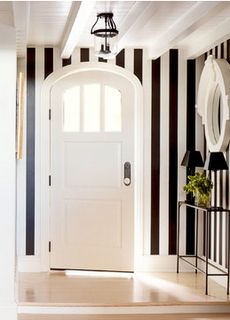 curved door and striped walls