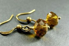 Amber Dangle Earrings. Crystal Earrings in Amber Glass. Handmade Jewelry. by StumblingOnSainthood from Stumbling On Sainthood. Find it now at http://ift.tt/1Q404VC!