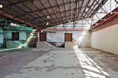 The renovation of a large industrial shed tucked away in Pretoria's CBD was carried out with a very light touch, providing amenities for its use as an events space while maintaining the integrity of the industrial fabric. Industrial Fabric, Industrial Sheds, Warehouse Design, Banks Building, Pretoria, Light Touch, Architecture, Integrity, Events