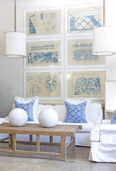 Fabric samples stretched inside white frames creates a relaxed and eye-catching wall display.