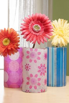 Glass vases decoupaged with patterned tissue...could cut/tear complimenting colors of tissue or could cover with lace or textured scrapbook paper instead.