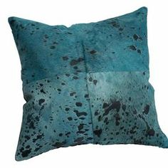 """Handmade turquoise cowhide pillow.  Product: PillowConstruction Material: CowhideColor: Turquoise and blackFeatures:  HandmadeInsert included Dimensions: 18"""" x 18""""Cleaning and Care: Spot treat with a mild detergent and water. Professional cleaning is recommended if necessary."""