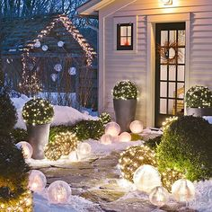 Ice globes make stunning luminaries that you won't find anywhere else on your block. Lit topiaries continue the festive collection of holiday orbs.This look is perfect for a holiday party, as the ice globes may melt away by the end of the night./